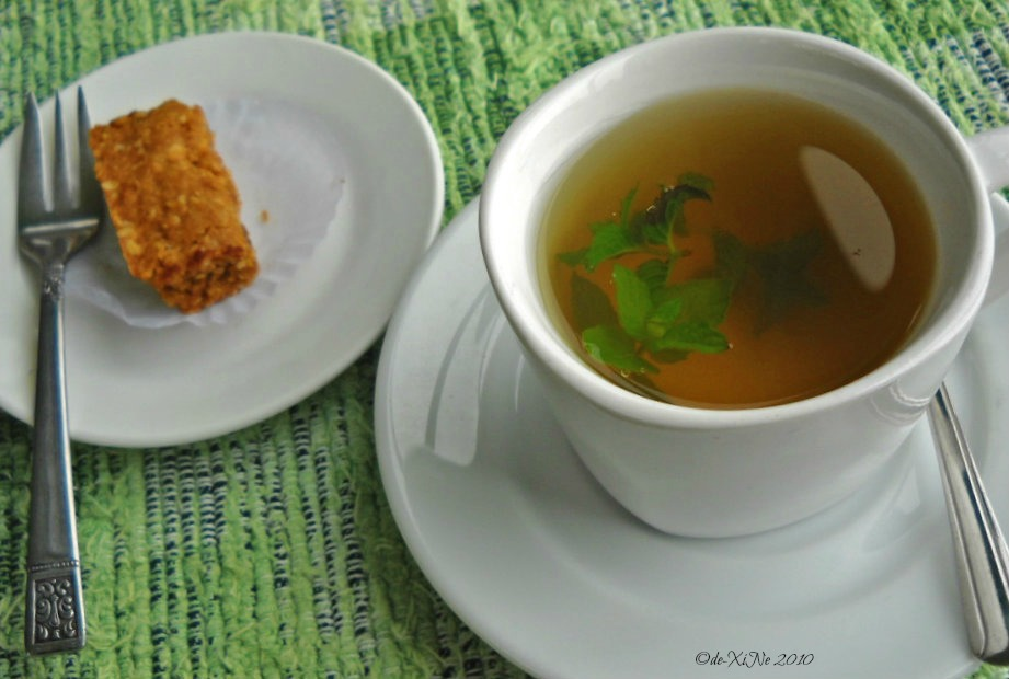 Eve's Garden homemade dessert with a cup of ginger ginseng with mint tea.