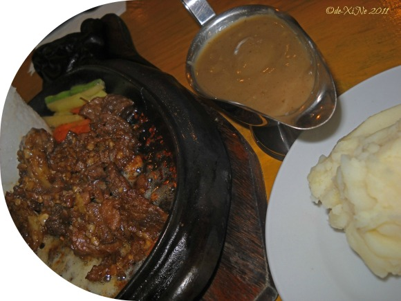 Tender Joe's Steakhouse sizzling shank meat and mashed potatoes and gravy