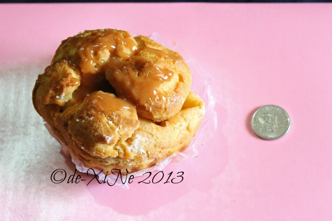 Sweetmates cream puff size comparison with the 1 peso coin