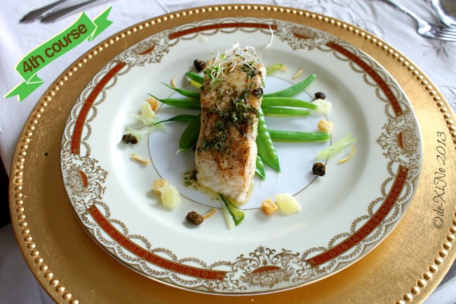 Mama's Table seafood seared baramundi on asparagus served Grenobloise style w/lemon supremes, lemon zest, parmesan croutons, fried capers and chives with brown butter parsley lemon sauce
