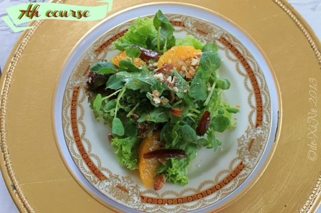Mama's Table digestif romaine, greens, watercress and arugula with orange supremes, almonds and dates served with citrus honey and mint vinaigrette