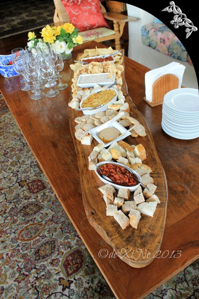 Mama's Table board of bread, crostini, chicharon, lime Tostitos, pate foie gras, artichoke mozzarella & parmesan spread, semi cured tomato w/chorizo, smoked bangus mousse, chili con carne