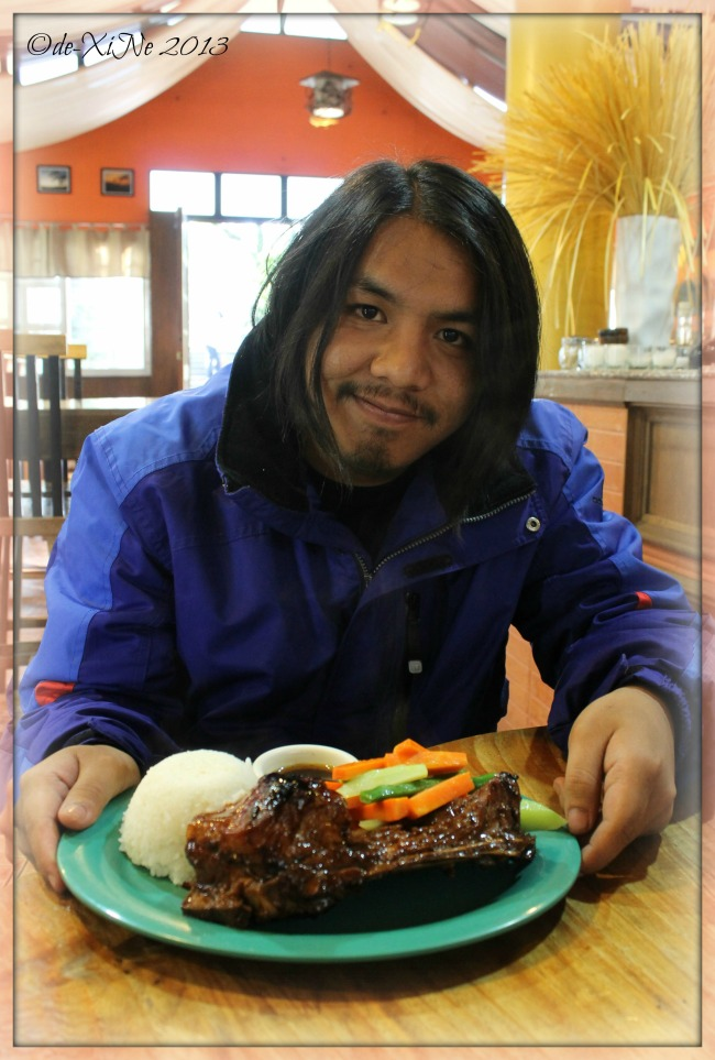 Beggang Resto Grill Race and his dinosaur spare rib combo meal