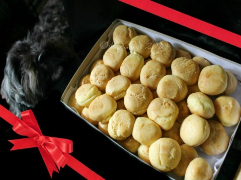 Jo's Aunt's cream puffs being inspected by my furry friend