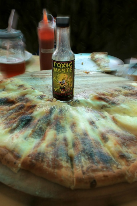 Grumpy Joe Baguio pizza and toxic waste extract hot sauce