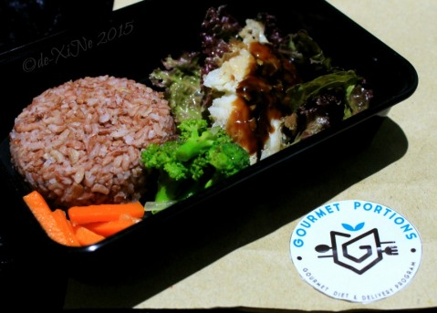 Baguio Gourmet Portions grilled dory in oyster sauce served with sauteed veg on brown rice
