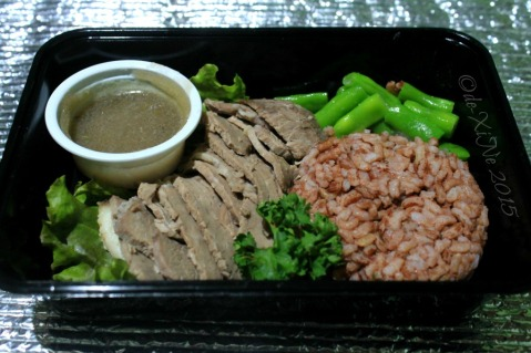 Baguio Gourmet Portions roasted beef sirloin in red wine sauce served with mixed vegetables on brown rice