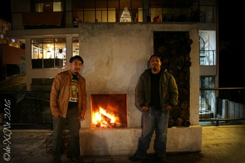 Baguio Ozark Private Table Race and Sir Omeng of Eats OA standing by the free standing fireplace