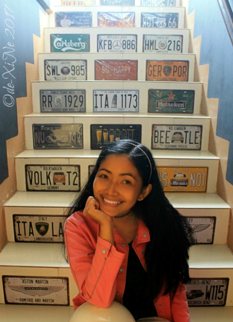 license plate laden stairway to Baguio Calsada Bistro