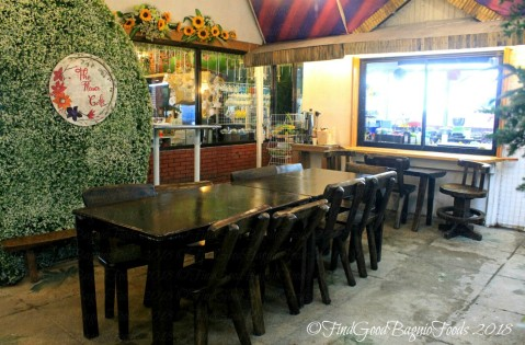 dining table with a view of the kitchen at Baguio The Flower Cafe at Villa Romana Hotel 2018