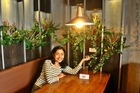 Vanna White-ing the electrical outlet at Baguio The Terminal Resto Cafe 2019